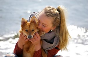 Smiling Woman with happy dog